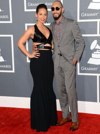 Alicia Keys in a Azzedine Alaia gown whith hubby Swizz Beatz