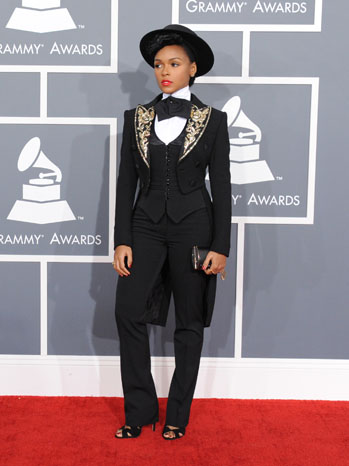 Janelle Monae arrives  in a Against Nature vest and shirt,  Moschino jacket and a Ralph Lauren hat.