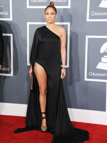 Jennifer Lopez showed off her legs in a revealing black Anthony Vaccarello gown with Tom Ford sandals