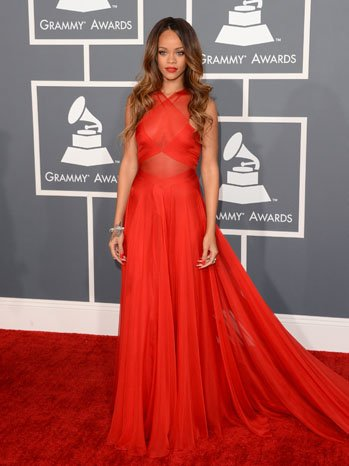 Rihanna wore a red hot  custom Azzedine Alaia dress, Neil Lane jewelry and Manolo Blahnik shoes. Riri cleans up quite good.