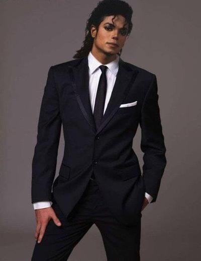 The King Of Pop - Michael Jackson with a great fitting shirt and suit with the cuff showing below jacket sleeve