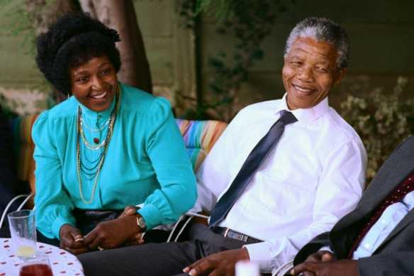 Madiba sits in the backyard in front of the international press corps with his beloved wife, Winnie, the day after his release from prison.