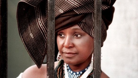 Winnie Mandela fell in love with and married Nelson Mandela when she was 24 years old. They had two children — both girls — during the two years before Mandela went to prison. Winnie herself was placed in solitary confinement for 18 months and was banished for nine years under house arrest in Brandfort. Through it all, Winnie remained the public persona of her husband. 1986
