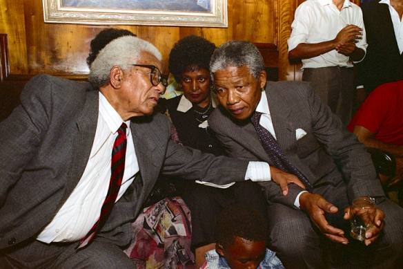 Sitting with Walter Sisulu, who had spent 27 years in prison with Mandela, just minutes after his release, they confer seconds before Mandela made his first public speech to the world.
