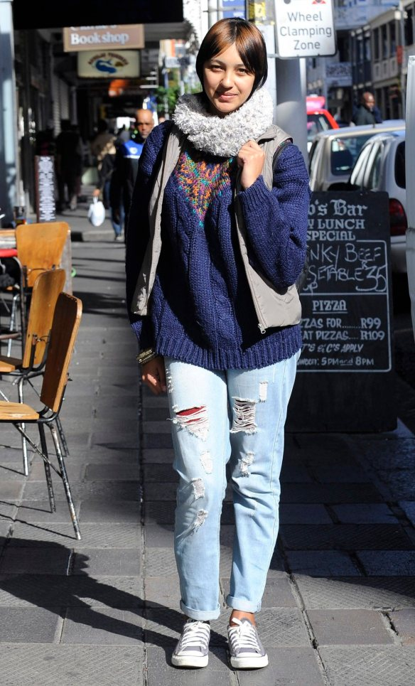 "Kauthar Jacobs, 19, from Mitchells Plain, bought her vintage ripped jeans from Mr Price. ""I like the laidback vintage denim look and that a good pair of jeans goes with just about everything."""