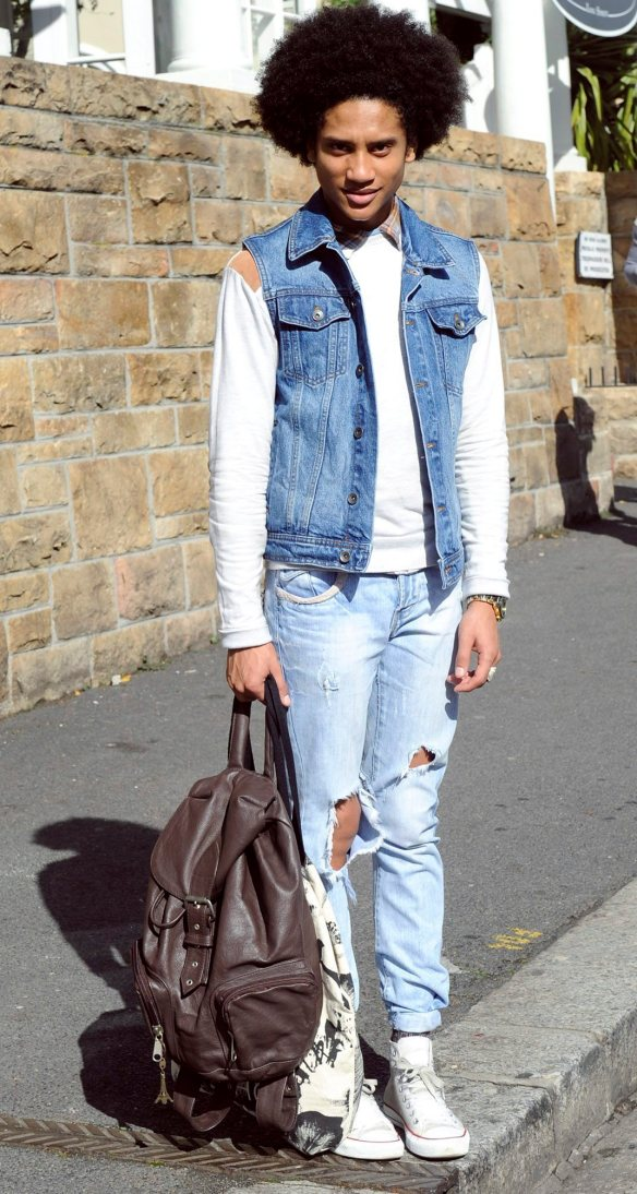 """Edwarren Jameson, 23, wears jeans from Markham and a denim jacket from Topshop. """"I like to mix and match denim, one shade lighter than the other,"""" he says. """"Black denim is the colour for this winter – from the washed-out look to the plain black."""""""