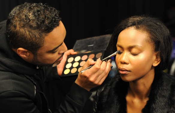 M.A.C. Cosmetics resident senior artist Keagan Cafun applying makeup on Azola. Picture by Tracey Adams